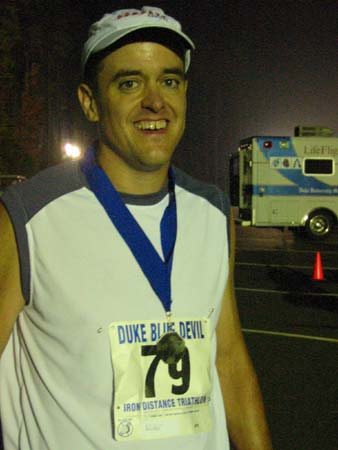 At the finish of my first LONG triathlon (140.6 miles, 14 hrs 49 minutes)