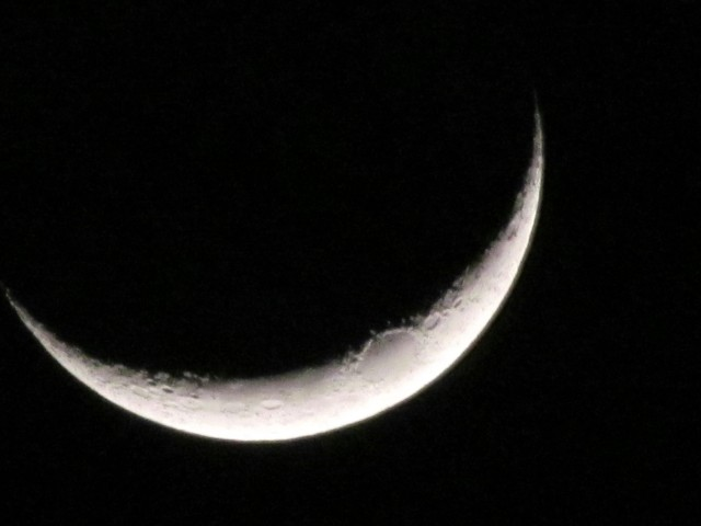 "Three day old moon. Fun picture. You can tell it's ""waxing"" or growing because it's light on the right side."