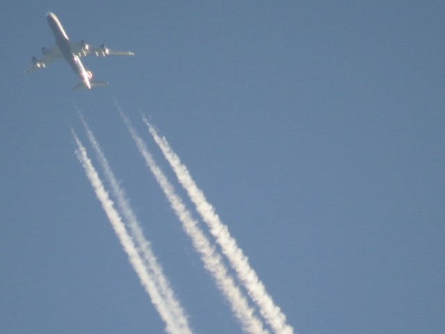 Four engines, four contrails