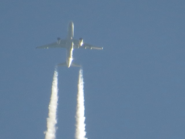 Twin engine jet with contrails: