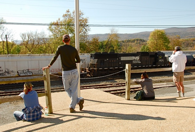 Kristin, Shane, Aileen and some crazy guy taking pictures of a train.