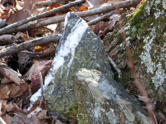 Granite with a streak of quartz.