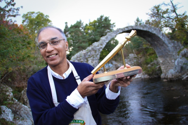 Golden Spurtle held (and won) by Dr. Izhar Khan of Aberdeen, Scotland