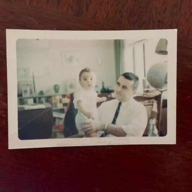 My late father holding me in 1962. Picture taken by his father.