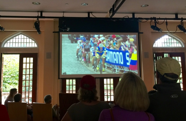 Picture of a TV picture of the cyclists climbing the cobblestones on Libby Hill for the first time today.